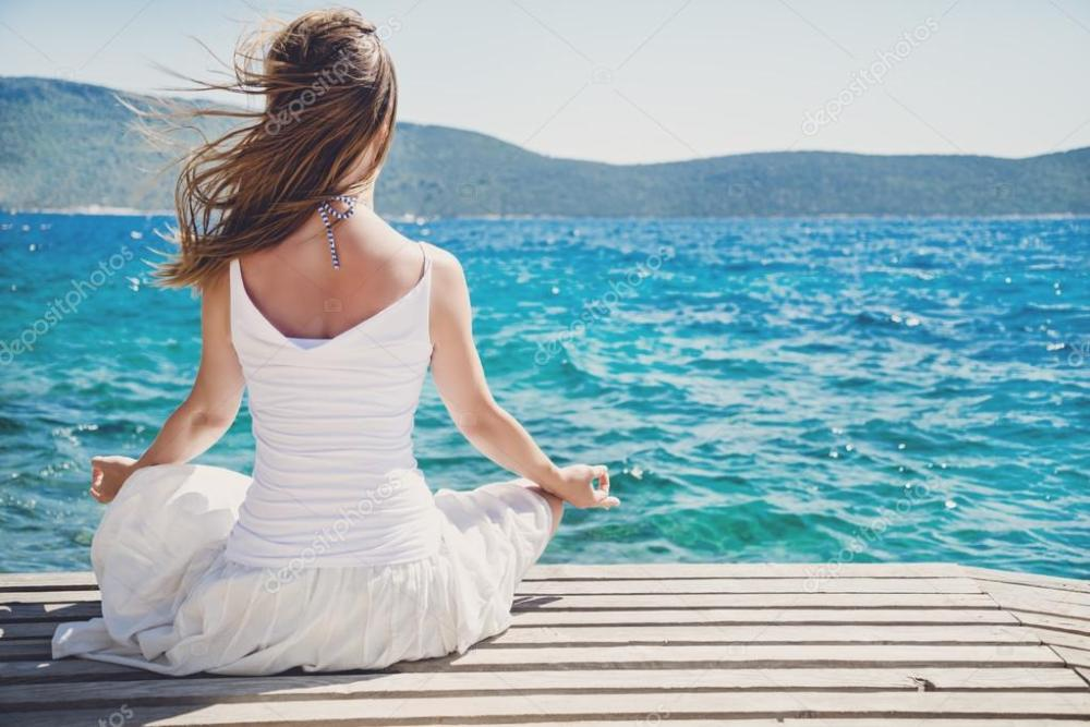 depositphotos_50878365-stock-photo-woman-meditating-at-the-sea