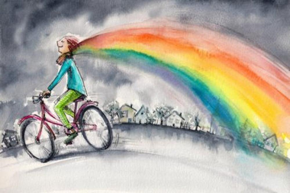chica-en-bici-de-la-que-sale-un-arco-iris-1