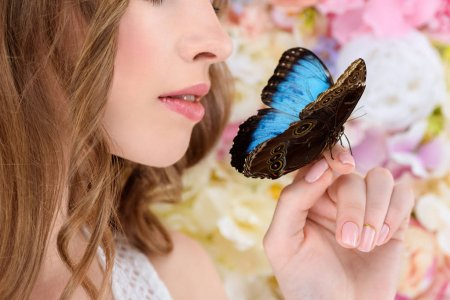 depositphotos_183514712-stock-photo-cropped-shot-young-woman-butterfly